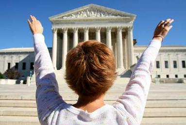 Woman worshipping the Supreme Court building