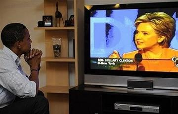 Obama watches Hillary at the DNC