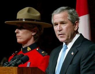 George Bush and what appears to be the prime minister of Canada