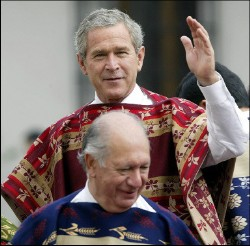Bush in a poncho