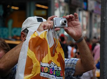 Tourist taking a photo in Times Square